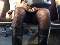Boots and pantyhose girl gives him an upskirt view on the train
